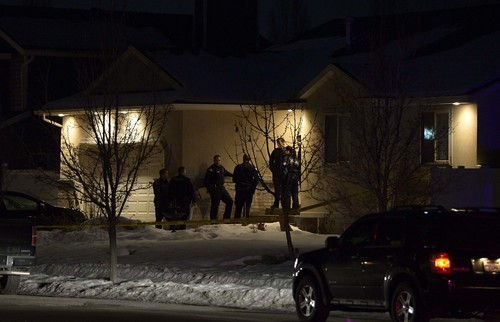 Leah Hogsten  |  The Salt Lake Tribune Syracuse Police officers investigate the scene where three people died in a shooting in Syracuse at 2133 W. 1175 South, Tuesday, January 14, 2014.