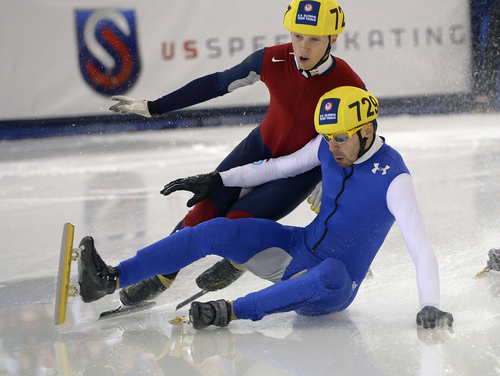 Scott Sommerdorf   |  The Salt Lake Tribune Keith Carroll Jr. and Travis Jayner crash during their Men;s 500 meter final at the Kearns Olympic Oval, Saturday, January 4, 2014. Kyle Uyehara won with a time of 44.523.