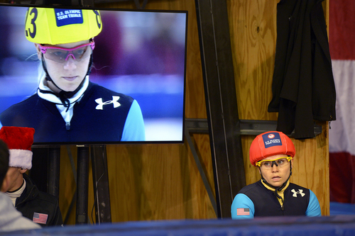Scott Sommerdorf   |  The Salt Lake Tribune Jessica Smith watches as another heat with Emily Scott (on screen) is about to start. Smith had just won her 500 meter quarterfinal heat at the Kearns Olympic Oval, Saturday, January 4, 2014.