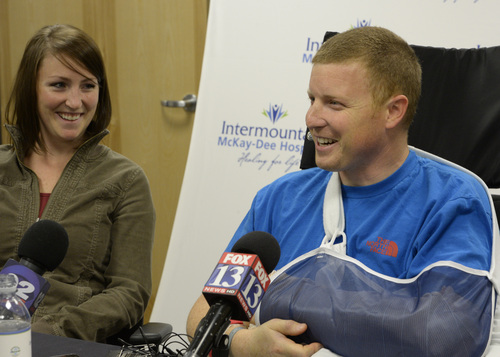 Rick Egan  | The Salt Lake Tribune   Emilee Morgan (left) listens as her husband, Matt Morgan, talks about how he survived an avalanche near the Idaho-Utah border on Saturday, during a press conference at the McKay-Dee Hospital, Wednesday, January 15, 2014.