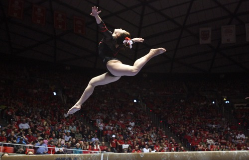 Kim Raff  |  The Salt Lake Tribune Utah gymnast Becky Tutka performs her routine on the beam during a meet against Florida at the Huntsman Center in Salt Lake City on March 16, 2013. Utah went on to beat Florida in the meet.
