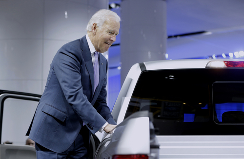 Vice President Joe Biden looks over a Ford F-150 truck during a tour of the North American International Auto in Detroit, Thursday, Jan. 16, 2014. Biden said the U.S. auto industry's resurgence since the 2009 federal bailout provides a strong basis for a Motor City recovery.  (AP Photo/Carlos Osorio)