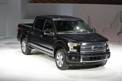 Ford unveils the new F-150 with a body built almost entirely out of aluminum. at the North American International Auto Show in Detroit, Monday, Jan. 13, 2014. (AP Photo/Carlos Osorio)