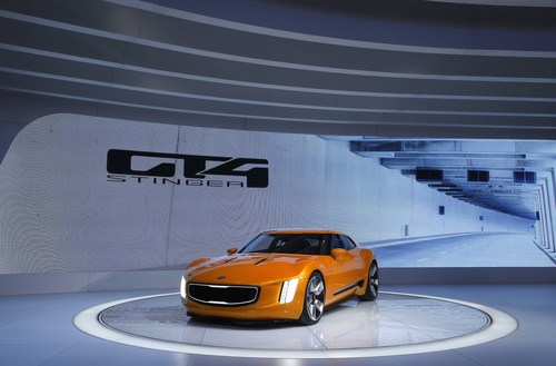 The Kia GT4 Stinger concept debuts during media previews during the North American International Auto Show in Detroit, Monday, Jan. 13, 2014. (AP Photo/Paul Sancya)