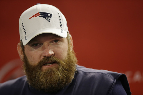 New England Patriots guard Logan Mankins listens to a reporter's question during a media availability at the NFL football team's facility in Foxborough, Mass., Wednesday, Jan. 15, 2014. The Patriots will play the Denver Broncos in the AFC Championship game Sunday in Denver. (AP Photo/Stephan Savoia)