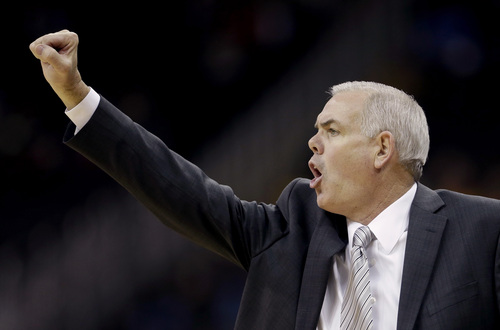 Brigham Young coach Dave Rose talks to his players during the first half of an NCAA college basketball game against Texas Monday, Nov. 25, 2013, in Kansas City, Mo. (AP Photo/Charlie Riedel)
