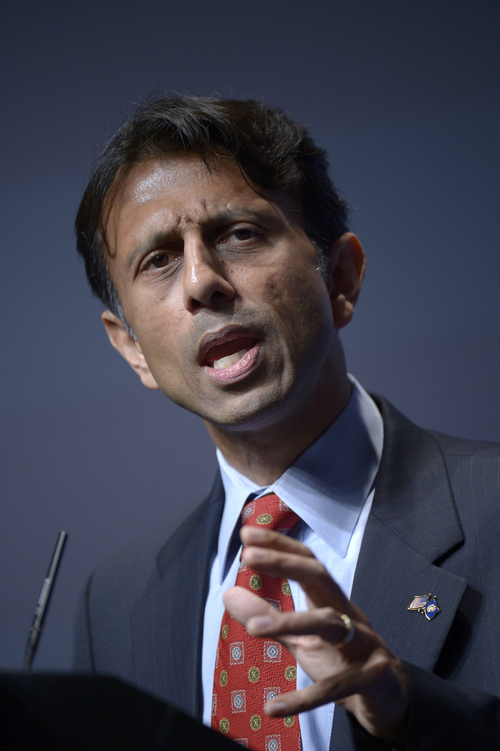 FILE - In this Aug. 30, 2013 file photo, Louisiana Gov. Bobby Jindal addresses attendees during the Americans for Prosperity Foundation's Defending the American Dream Summit in Orlando, Fla.  A slow but steady economic recovery is generating more tax revenue than many states had anticipated, offering elected officials tantalizing choices about whether to ply voters with tax breaks, boost spending for favorite programs or sock away cash for another rainy day. The Republican Louisiana Governor wants to steer the surplus to education and health care. (AP Photo/Phelan M. Ebenhack, File)