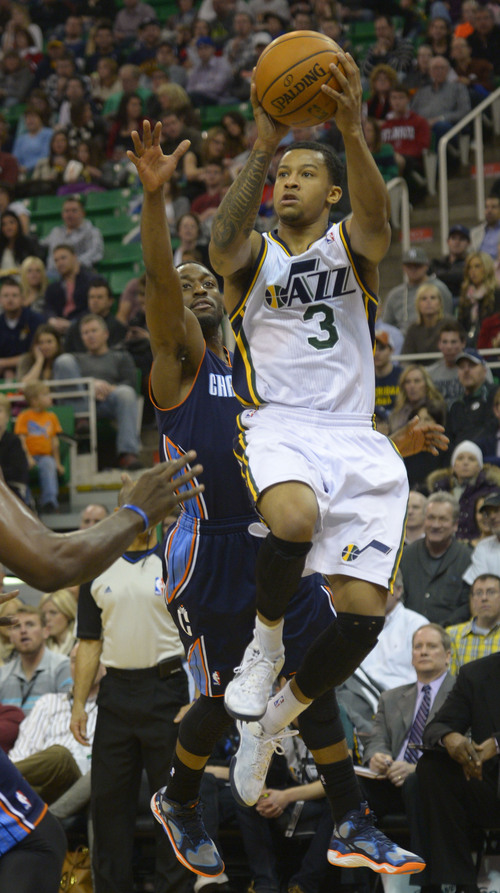 Rick Egan  | The Salt Lake Tribune   Utah Jazz point guard Trey Burke (3) scores for the Jazz, in NBA action  Utah Jazz vs. The Charlotte Hornets, at the EnergySolutions Arena, Monday, December 30, 2013.,