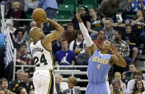 Utah Jazz's Richard Jefferson (24) shoots as Denver Nuggets' Randy Foye (4) defends in the second quarter during an NBA basketball game, Monday, Jan. 13, 2014, in Salt Lake City. (AP Photo/Rick Bowmer)