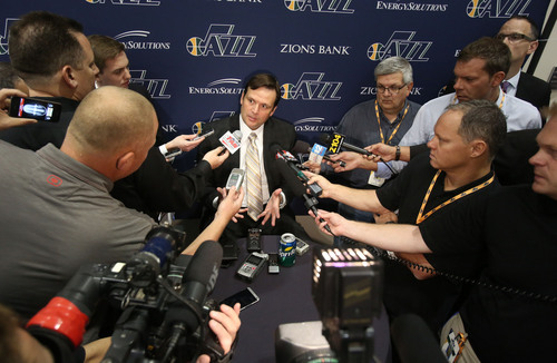 Francisco Kjolseth  |  The Salt Lake Tribune General manager of the Utah Jazz Dennis Lindsey is surrounded by the media as he attends Media Day at the Zions Bank Basketball Center in Salt Lake on Monday, Sept. 30, 2013.