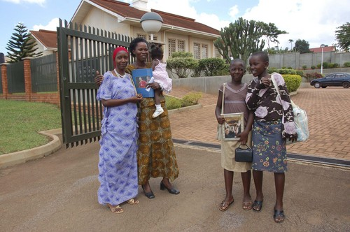Mike Stack | Courtesy Sister Ekeya (far left) and Diana Mutyaba (holding the child) enjoy socializing and discussing Mormon principles with two Young Women outside an LDS meeting house in Mukono, Uganda.