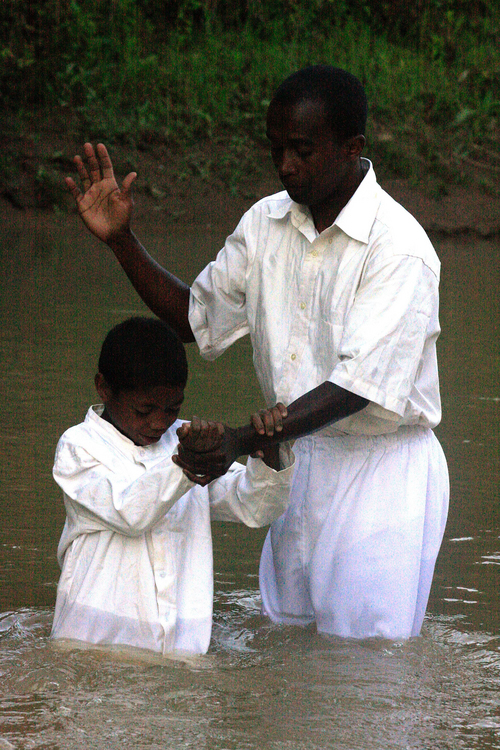 | Courtesy The Church of Jesus Christ of Latter-day Saints A river baptism in Africa