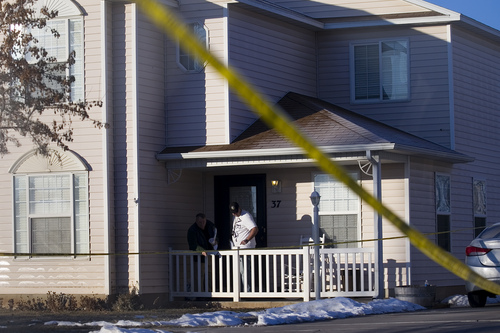 Police investigate a home, Friday, Jan. 17, 2014, in Spanish Fork, Utah where five people were found dead on Thursday.  A 34-year-old officer shot and killed his wife, mother-in-law and two young children and turned the gun on himself, authorities said Friday.  Spanish Fork police said the five were found dead about 11 p.m. Thursday, when co-workers reported Joshua Boren didn't show up for his night shift as a patrol officer at the Lindon Police Department. (AP Photo/Daily Herald, Mark Johnston)