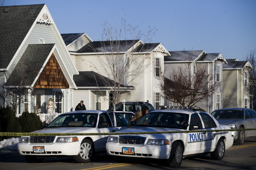 Police gather outside a home, Friday, Jan. 17, 2014, in Spanish Fork, Utah where five people were found dead on Thursday.  A 34-year-old officer shot and killed his wife, mother-in-law and two young children and turned the gun on himself, authorities said Friday.  Spanish Fork police said the five were found dead about 11 p.m. Thursday, when co-workers reported Joshua Boren didn't show up for his night shift as a patrol officer at the Lindon Police Department. (AP Photo/Daily Herald, Mark Johnston)
