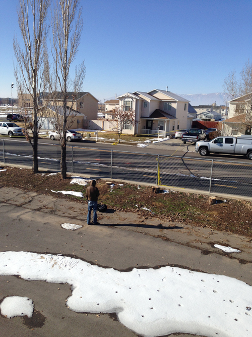 Brooke Adams     The Salt Lake Tribune The 2-story in the center is the home of officer Joshua Boren, who apparently shot and killed his wife two children and mother-in-law on Thursday night, before killing himself.