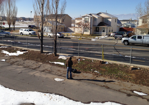 Brooke Adams  |  The Salt Lake Tribune The 2-story in the center is the home of officer Joshua Boren, who apparently shot and killed his wife two children and mother-in-law on Thursday night, before killing himself.