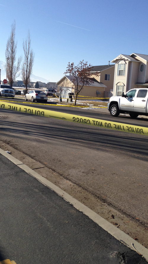 Brooke Adams     The Salt Lake Tribune The 2-story to the right is the home of officer Joshua Boren, who apparently shot and killed his wife two children and mother-in-law on Thursday night, before killing himself.