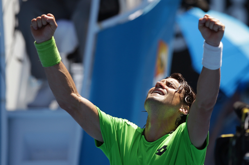 David Ferrer of Spain celebrates after winning over Jeremy Chardy of France  during their third round match at the Australian Open tennis championship in Melbourne, Australia, Friday, Jan. 17, 2014.(AP Photo/Aaron Favila)