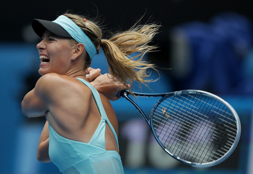 Maria Sharapova of Russia hits a backhand return to Alize Cornet of France during their third round match at the Australian Open tennis championship in Melbourne, Australia, Saturday, Jan. 18, 2014.(AP Photo/Aaron Favila)