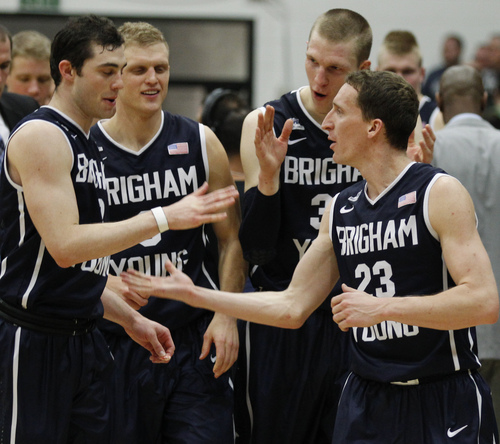 BYU's Matt Carlino, Tyler Haws, Nate Austin and Skyler Halford, from left, celebrate after BYU defeated San Francisco 83-76 in an NCAA college basketball game, Thursday, Jan. 16, 2014, in San Francisco. (AP Photo/George Nikitin)