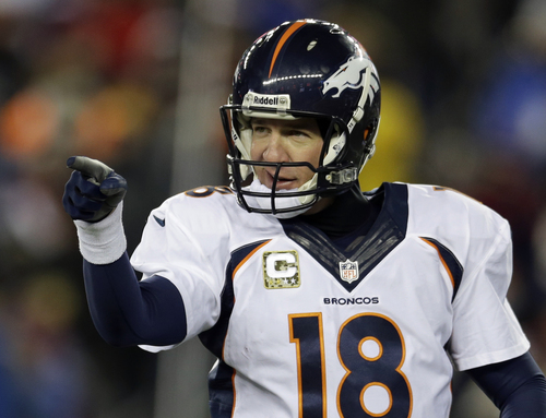 Steven Senne | The Associated Press Denver quarterback Peyton Manning reacts to a touchdown he threw to Jacob Tamme in Foxborough, Mass.