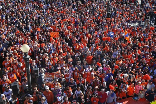 Denver Broncos fans cheer at a pep rally in downtown in Denver, Friday, Jan. 17, 2014. The Broncos are scheduled to host the New England Patriots on Sunday in the AFC championship NFL football game. (AP Photo/Brennan Linsley)