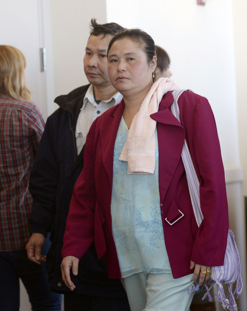 Al Hartmann  |  The Salt Lake Tribune Cartoon and Pearlly Wah, parents of Hser Ner Moo, leave court after final summations and the jury convenes at Esar Met's murder trial in Salt Lake City Friday January 17, 2014. Esar Met is accused of killing 7-year-old Hser Ner Moo, who disappeared on March 31, 2008.