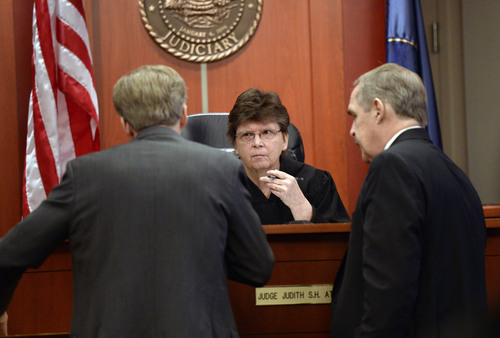 Al Hartmann  |  The Salt Lake Tribune Defense lawyer Michael Peterson, left, and prosecuter Robert Parrish huddle with Judge Judith Atherton before making their final summations to the jury in Esar Met's murder trial in Salt Lake City Friday January 17, 2014. Esar Met is accused of killing 7-year-old Hser Ner Moo, who disappeared on March 31, 2008.