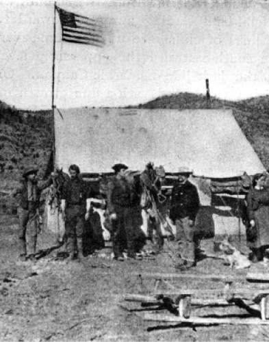 Scene probably at start of Powell's 2nd expedition at Green River, Wyoming in 1871. Major John Wesley Powell was a soldier who lost his arm in the Civil War, and went on to become a geology professor, American Indian expert, western conservation advocate, and an explorer who's most famous expedition was a 900-mile journey on the Green and Colorado Rivers in 1870.