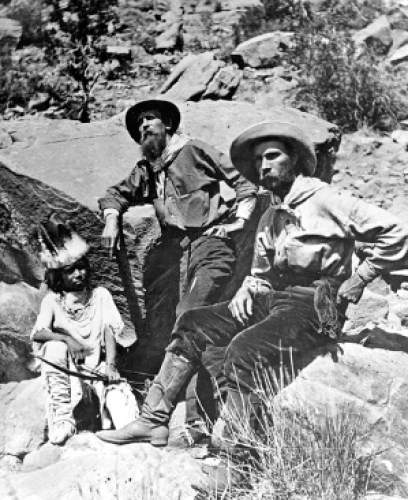 Frederick S. Dellenbaugh, circa 1930, re-enacting a photograph taken of him in 1871 during the 2nd expedition of John Wesley Powell down the Colorado River into the Grand Canyon. Dellenbaugh was a boatman and artist on Major Powell's second expedition.
