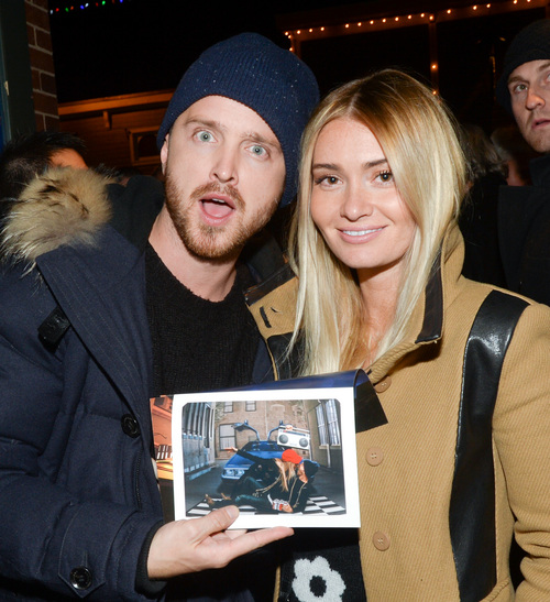 """Actor Aaron Paul poses with his Lauren Parsekian at the Chase Sapphire Preferred """"Hellion"""" premiere party during the Sundance Film Festival, on Friday, January 17, 2013 in Park City, Utah. (Photo by Evan Agostini/Invision for Chase Sapphire Preferred/AP Images)"""