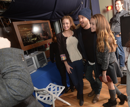 """Actor Aaron Paul poses with fans at the Chase Sapphire Preferred """"Hellion"""" premiere party during the Sundance Film Festival, on Friday, January 17, 2013 in Park City, Utah. (Photo by Evan Agostini/Invision for Chase Sapphire Preferred/AP Images)"""