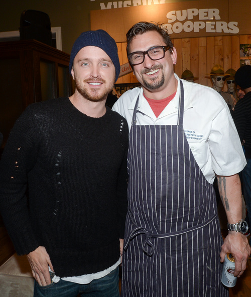 """Actor Aaron Paul, left, and chef Chris Cosentino at the Chase Sapphire Preferred """"Hellion"""" premiere party during the Sundance Film Festival, on Friday, January 17, 2013 in Park City, Utah. (Photo by Evan Agostini/Invision for Chase Sapphire Preferred/AP Images)"""