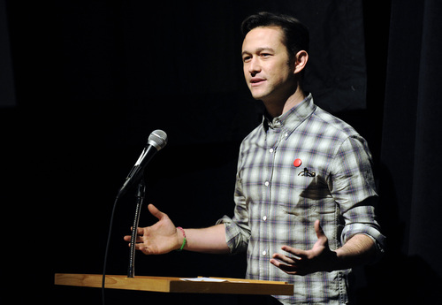 """Joseph Gordon-Levitt, the creator, director, host and executive producer of the online variety series """"HitRECord on TV,"""" addresses the audience before a New Frontier Films screening of the show at the 2014 Sundance Film Festival on Friday, Jan. 17, 2014 in Park City, Utah. (Photo by Chris Pizzello/Invision/AP)"""