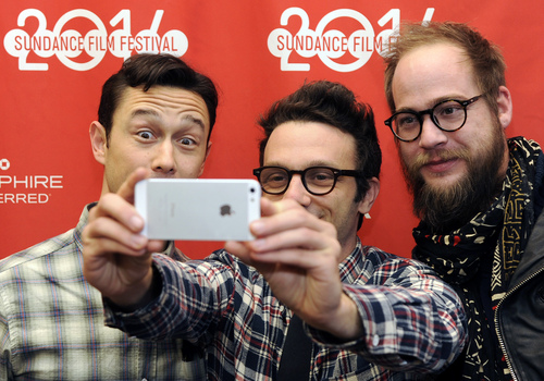 """Joseph Gordon-Levitt, the creator, director, host and executive producer of the online variety series """"HitRECord on TV,"""" left, poses for a photo with executive producer Jared Geller, center, and creative director Marke Johnson before a screening of the show at the 2014 Sundance Film Festival on Friday, Jan. 17, 2014 in Park City, Utah. (Photo by Chris Pizzello/Invision/AP)"""