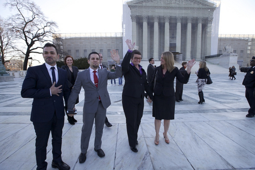"""The plaintiffs in the case to overturn California's ban on same-sex marriage -- from left: Paul Katami, Jeffrey Zarrillo, Kris Perry and Sandy Stier -- before the U.S. Supreme Court, in a scene from the documentary """"The Case Against 8."""" Courtesy HBO Documentary Films"""
