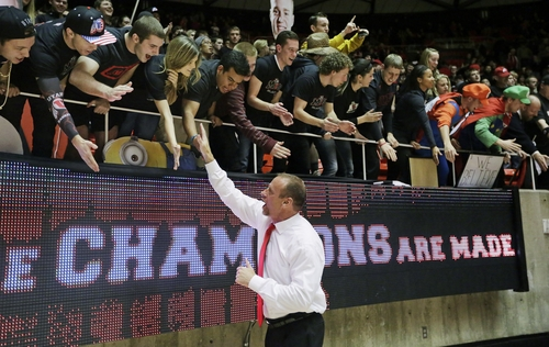 Utah head coach Larry Krystkowiak celebrates with the Utah students following their NCAA basketball game against Southern California Thursday, Jan. 16, 2014, in Salt Lake City. Utah won 84-66. (AP Photo/Rick Bowmer)