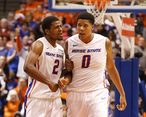 Boise State's Derrick Marks (2) and Ryan Watkins (0) react between plays during the second half of an NCAA college basketball game against Utah State in Boise, Idaho, Saturday, Jan. 18, 2014. Boise State defeated Utah State 78-74. (AP Photo/Otto Kitsinger)