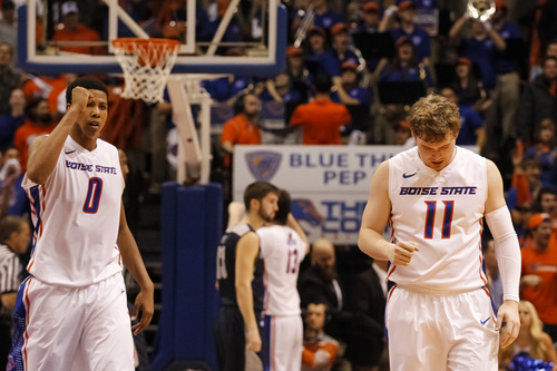 Boise State's Ryan Watkins (0) and Jeff Elorriaga (11) react after Boise State wins an NCAA college basketball game against Utah State in Boise, Idaho, Saturday, Jan. 18, 2014. Boise State defeated Utah State 78-74. (AP Photo/Otto Kitsinger)