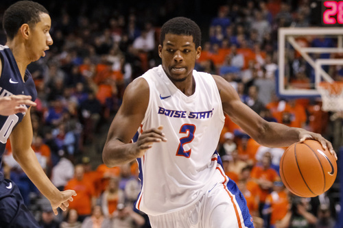 Boise State's Derrick Marks (2) moves the ball against Utah State's Marcel Davis (0) during the second half of an NCAA college basketball game in Boise, Idaho, on Saturday, Jan. 18, 2014. Boise State defeated Utah State 78-74. (AP Photo/Otto Kitsinger)