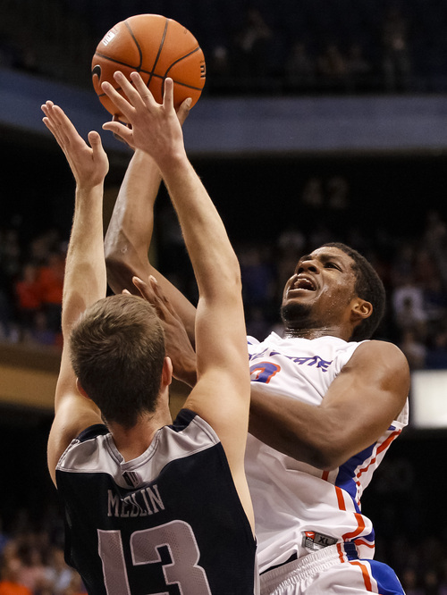 Boise State's Derrick Marks (2) scores overUtah State's Preston Medlin (13) with 23.6 seconds left during the second half of an NCAA college basketball game in Boise, Idaho, on Saturday, Jan. 18, 2014. Boise State defeated Utah State 78-74. (AP Photo/Otto Kitsinger)