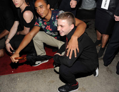"""FILE - In this Tuesday, June 18, 2013 file photo, Madonna's son, Rocco Ritchie, foreground, attends the world premiere of """"Madonna: The MDNA Tour"""" at the Paris Theatre in New York. Madonna is apologizing for using a racial slur to refer to her white son Instagram. On Friday night, Jan. 17, 2014, she posted a picture of her 13-year-old son boxing and used a hashtag that contained a racial slur. When fans objected, she defiantly called them haters, but in a statement to The Associated Press on Saturday, Jan. 18, 2014, she was contrite and said: """"Forgive me."""" (Photo by Evan Agostini/Invision/AP)"""