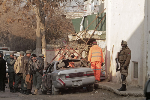 Afghan security forces investigate the aftermath of Friday's suicide attack and shooting in Kabul, Afghanistan, Saturday, Jan. 18, 2014. A suicide bomber blew himself up outside a Kabul restaurant filled with foreigners and affluent Afghans, while two gunmen snuck in through the back door and opened fire Friday in a brazen dinnertime attack that killed 16 people, officials said. (AP Photo/Rahmat Gul)