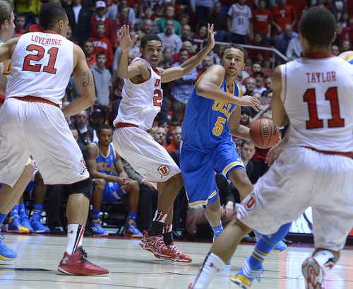 Scott Sommerdorf   |  The Salt Lake Tribune UCLA's Kyle Anderson drives through the Utah defense during second half play, Saturday, January 18, 2014. Utah beat UCLA 74-69.