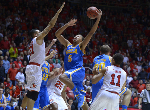 Scott Sommerdorf   |  The Salt Lake Tribune UCLA's Kyle Anderson goes up for two against Jordan Loveridge in second half play, Saturday, January 18, 2014. Utah beat UCLA 74-69.