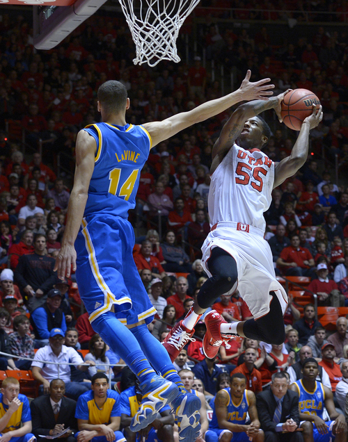 Scott Sommerdorf   |  The Salt Lake Tribune Utah's Delon Wright shoots against UCLA's Zach LaVine during first half play, Saturday, January 18, 2014. Utah held a 36-26 lead over UCLA at the half.
