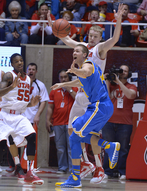 Scott Sommerdorf   |  The Salt Lake Tribune UCLA's Travis Wear reacts to losing the ball as Utah's Dallin Bachynski and Delon Wright, left, defend during first half play, Saturday, January 18, 2014. Utah held a 36-26 lead over UCLA at the half.