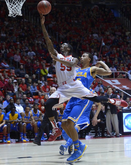 Scott Sommerdorf   |  The Salt Lake Tribune Utah's Delon Wright goes up for a layup during first half play against UCLA and  the defense of Kyle Anderson, Saturday, January 18, 2014. Utah held a 36-26 lead over UCLA at the half.