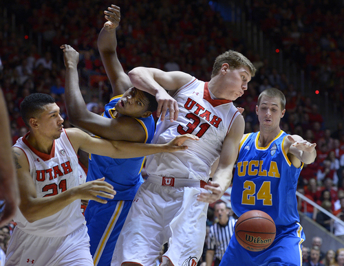 Scott Sommerdorf   |  The Salt Lake Tribune Jordan Loveridge, left, reaches as Utah's Dallin Bachynski tangles with UCLA's Tony Parker, second from left, and Travis Wear, right, while going for control of a rebound late in the second half, Saturday, January 18, 2014. Utah beat UCLA 74-69.