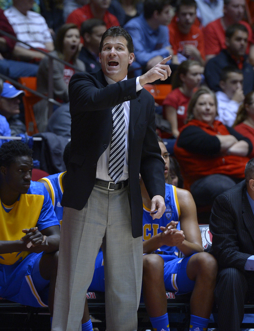 Scott Sommerdorf   |  The Salt Lake Tribune UCLA head coach Steve Alford sends in a play during first half action, Saturday, January 18, 2014. Utah held a 36-26 lead over UCLA at the half.